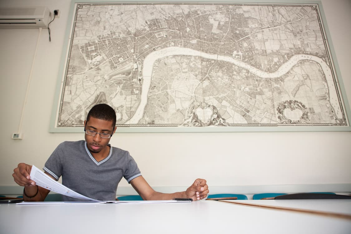 student looking at map