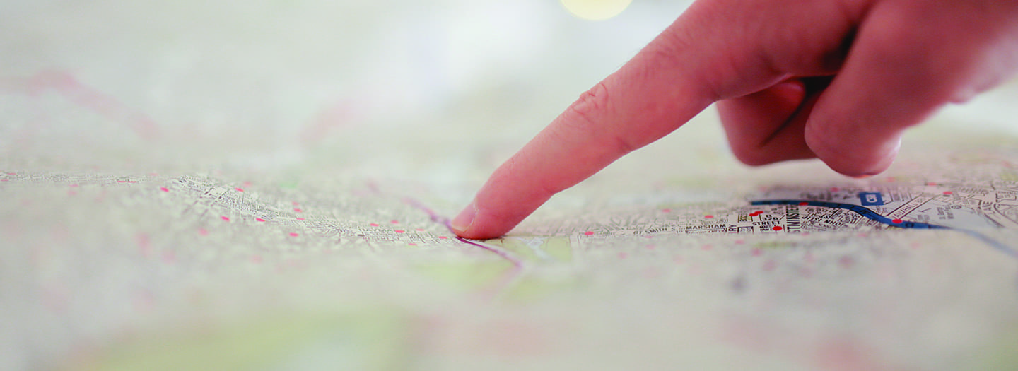 finger pointing on map